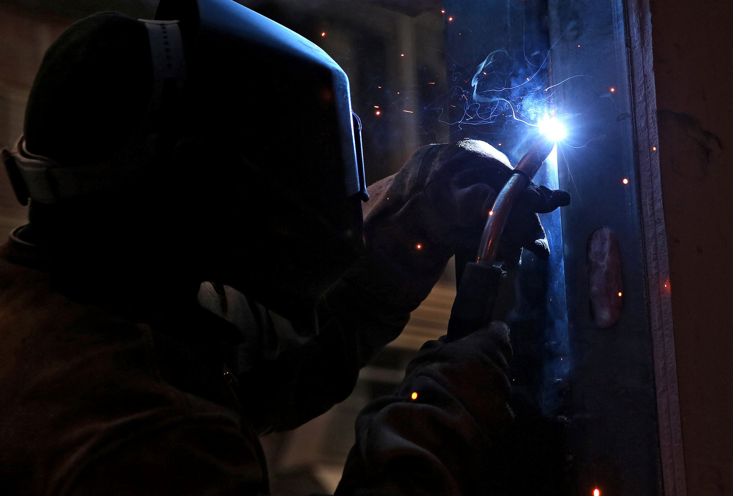 Welding the window frame to the apartment module.