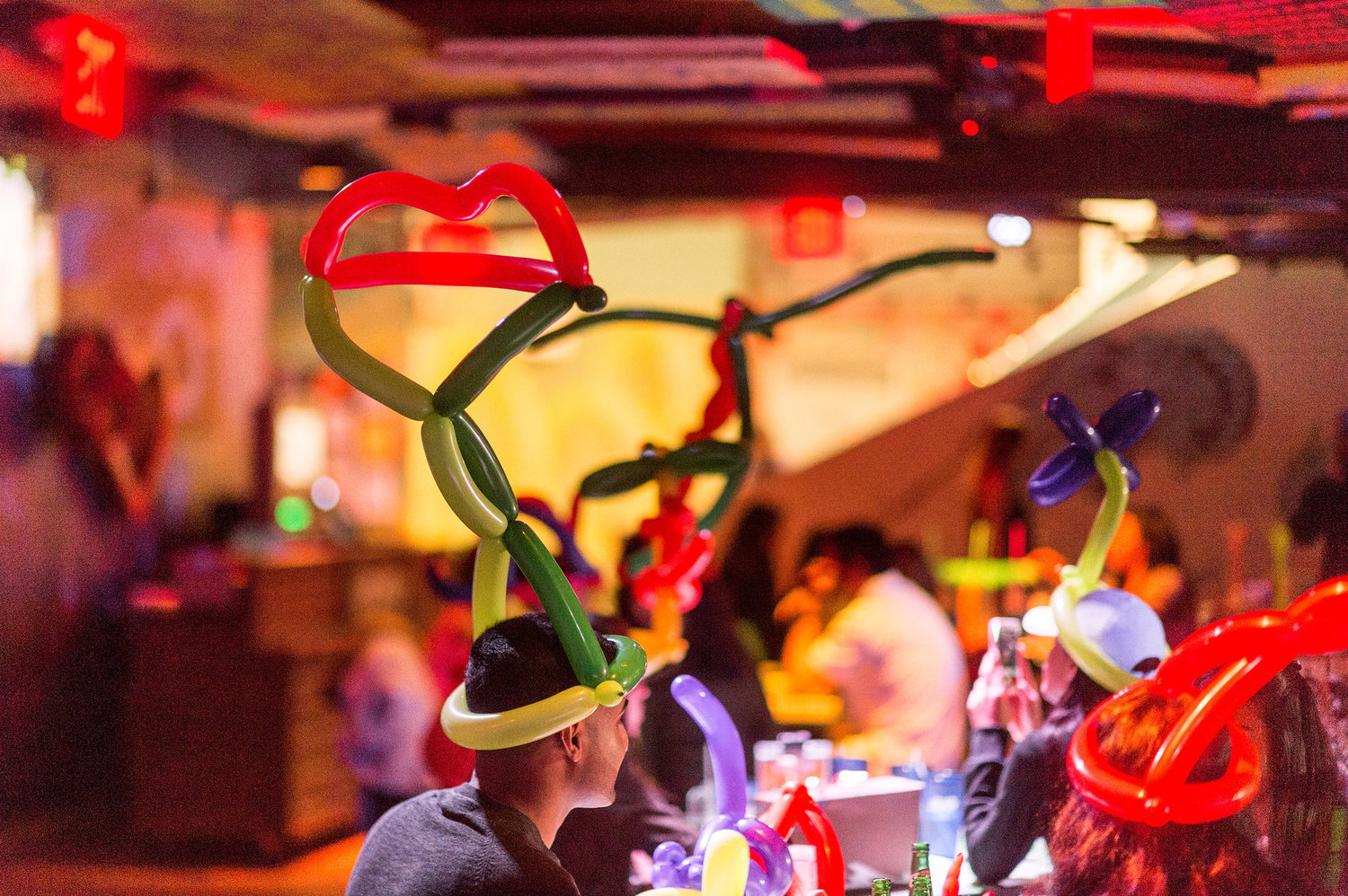 Many of the diners opt for balloon hats.