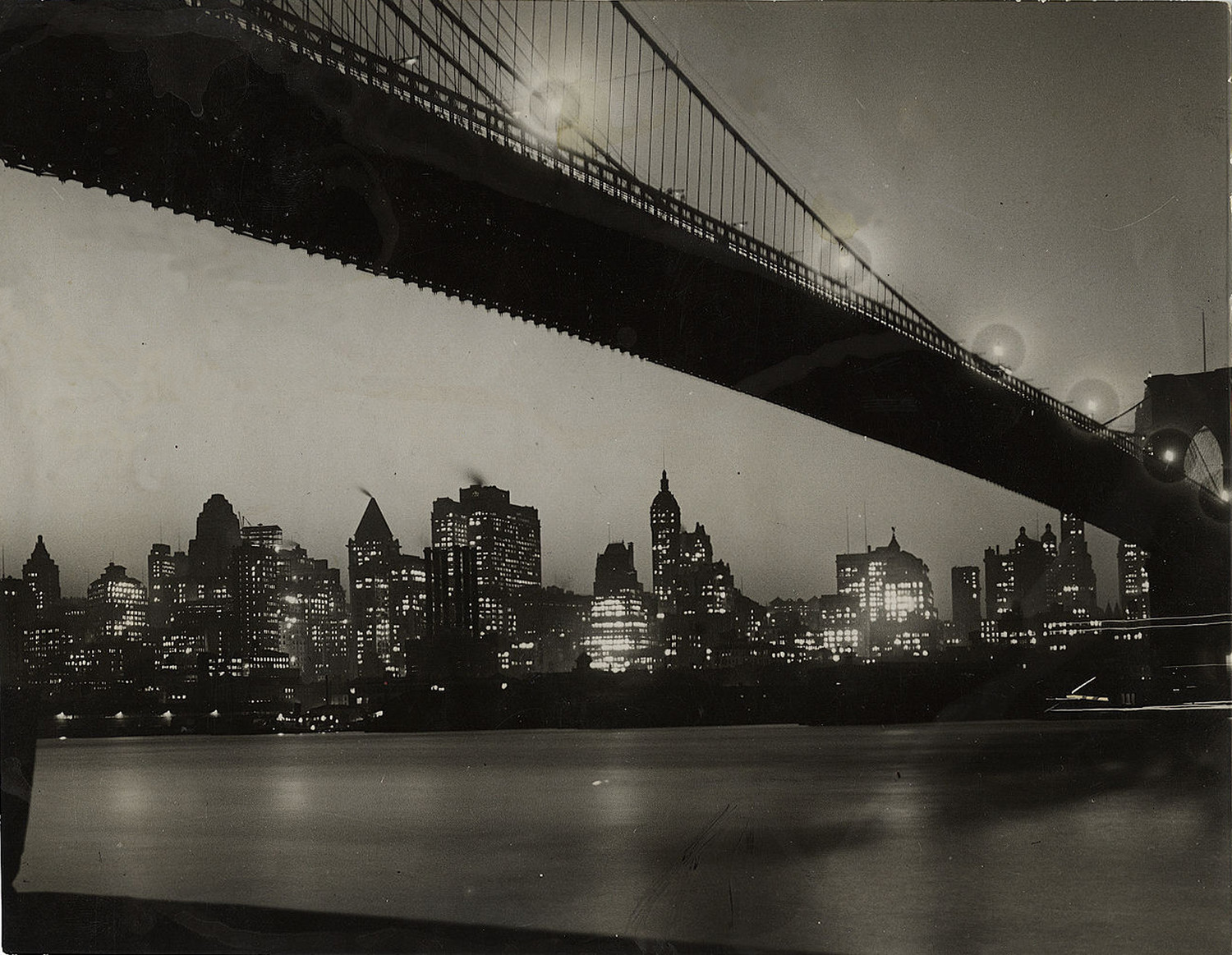 Old New York In Photos – Brooklyn Bridge & The Manhattan Skyline At Night 1928