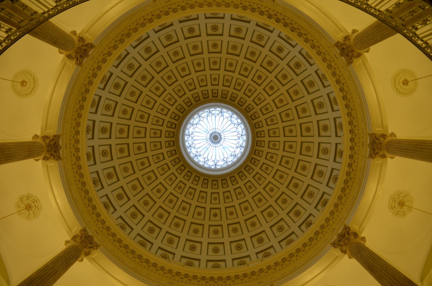 Before heading up the stairs to the second floor, take a look up to see the rotunda's dome.