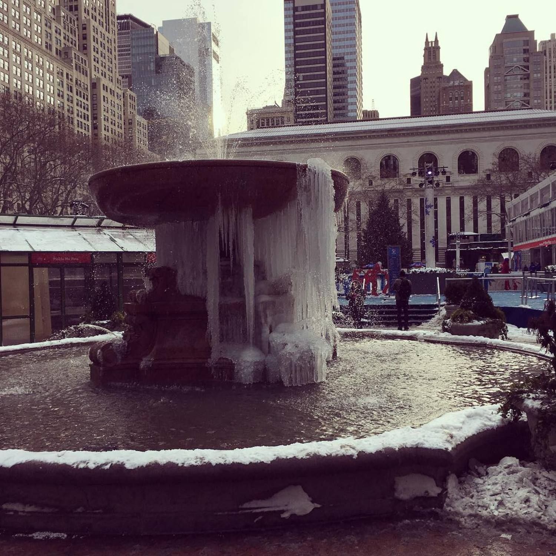 We call this 1/4 frozen. #bpfrozenfountain #gettingcloser #wintervillage #brrrryantpark