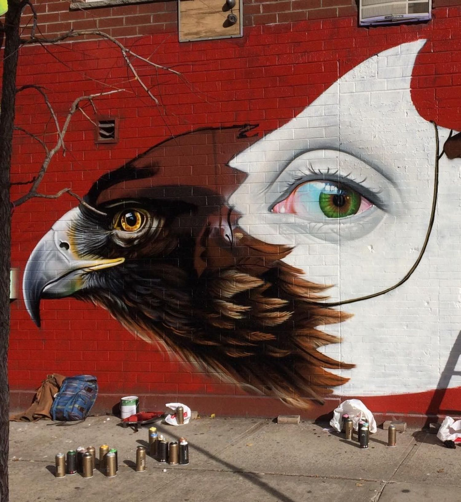 Almost there #freehand #sprayart #streetart #mural #newyork #mask #eye #eagle
