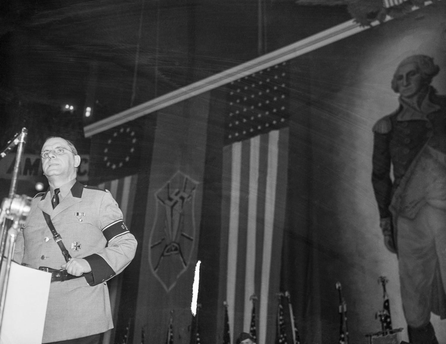 Fritz Kuhn, leader of the German American Bund, addresses the Nazi rally as protesters clash with police outside.