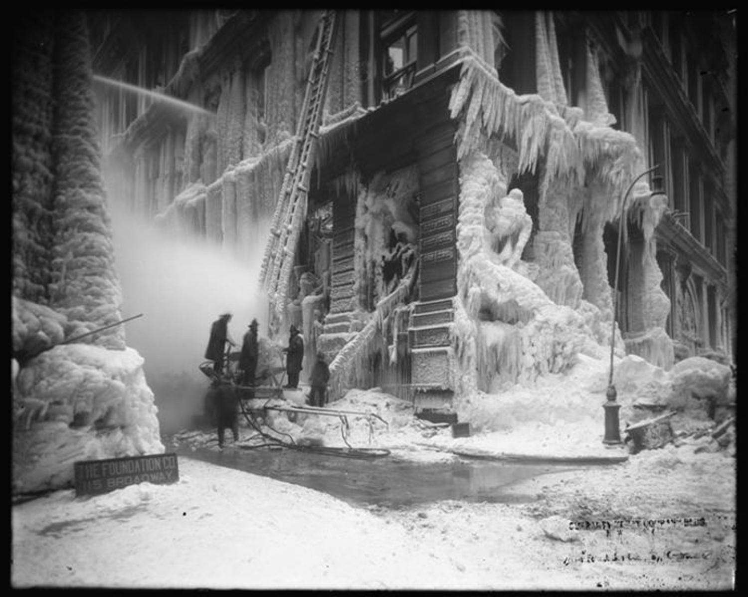 Cedar Street and Broadway. Fire at old Equitable Building Guaranty Trust Company Building, melting ice with steam. 1/12/1912