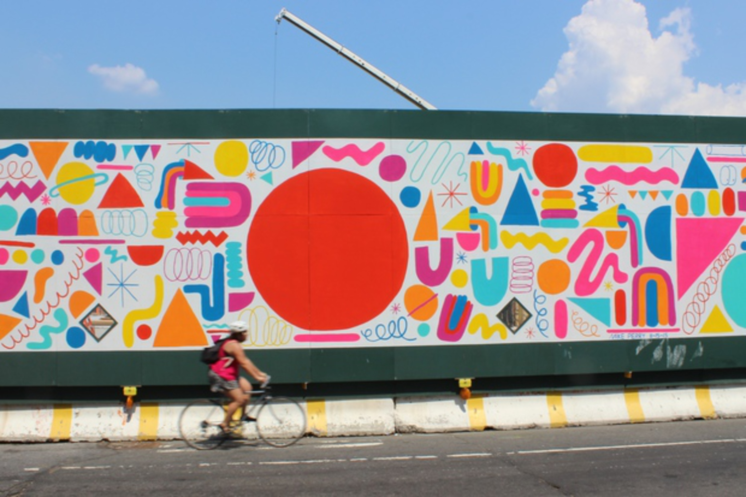Lead artist Mike Perry's mural shows off his bold, bright style, which usually includes a lot of colorful squiggles.