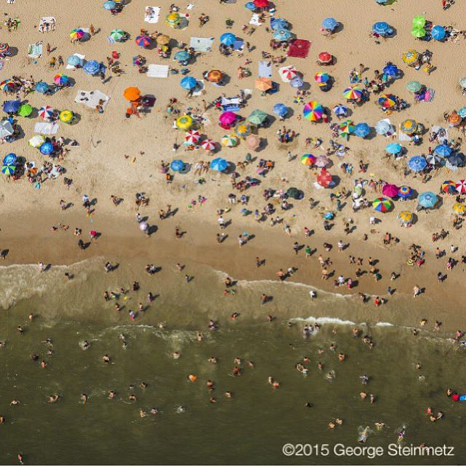 Photograph by George Steinmetz @geosteinmetz / @thephotosociety  Through the 1950s, a million people might squeeze onto New York City's Coney Island Beach on a hot summer day and newspapers would send photographers to Coney Island on the 4th of July to capture the festive scene—in some pictures, you can't see the sand for the people. Today, relaxed sunbathers have more room to stretch out. #airconditioning