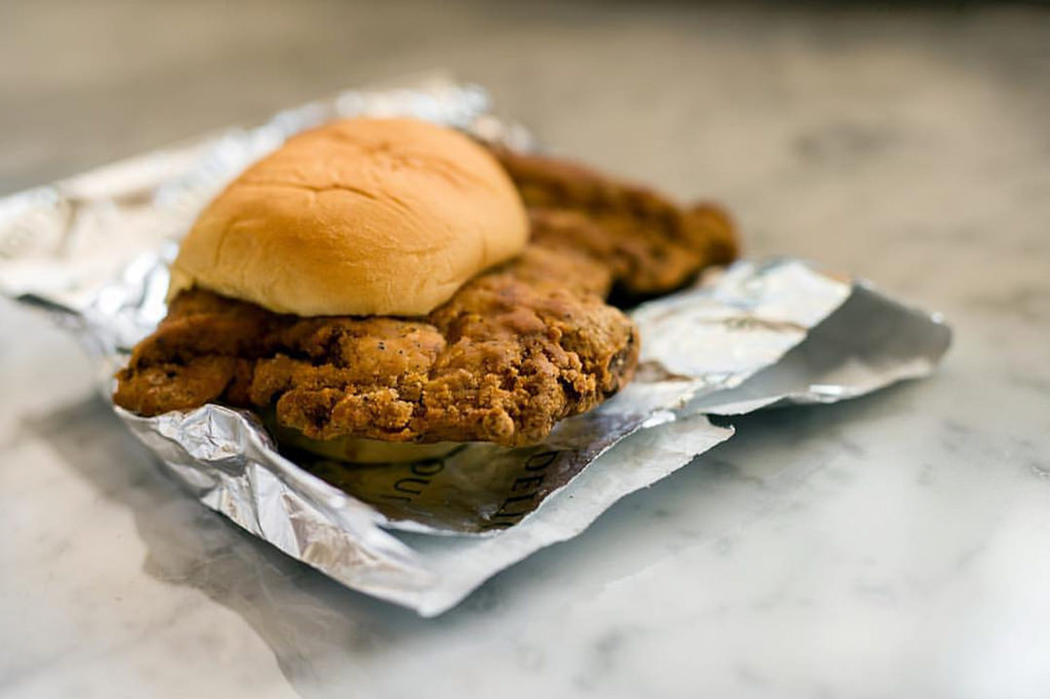 The Fuku #friedchicken sandwich by David Chang is a slab of crispy, juicy chicken with pickles and a buttered Martin's potato roll was pretty badass for $8.