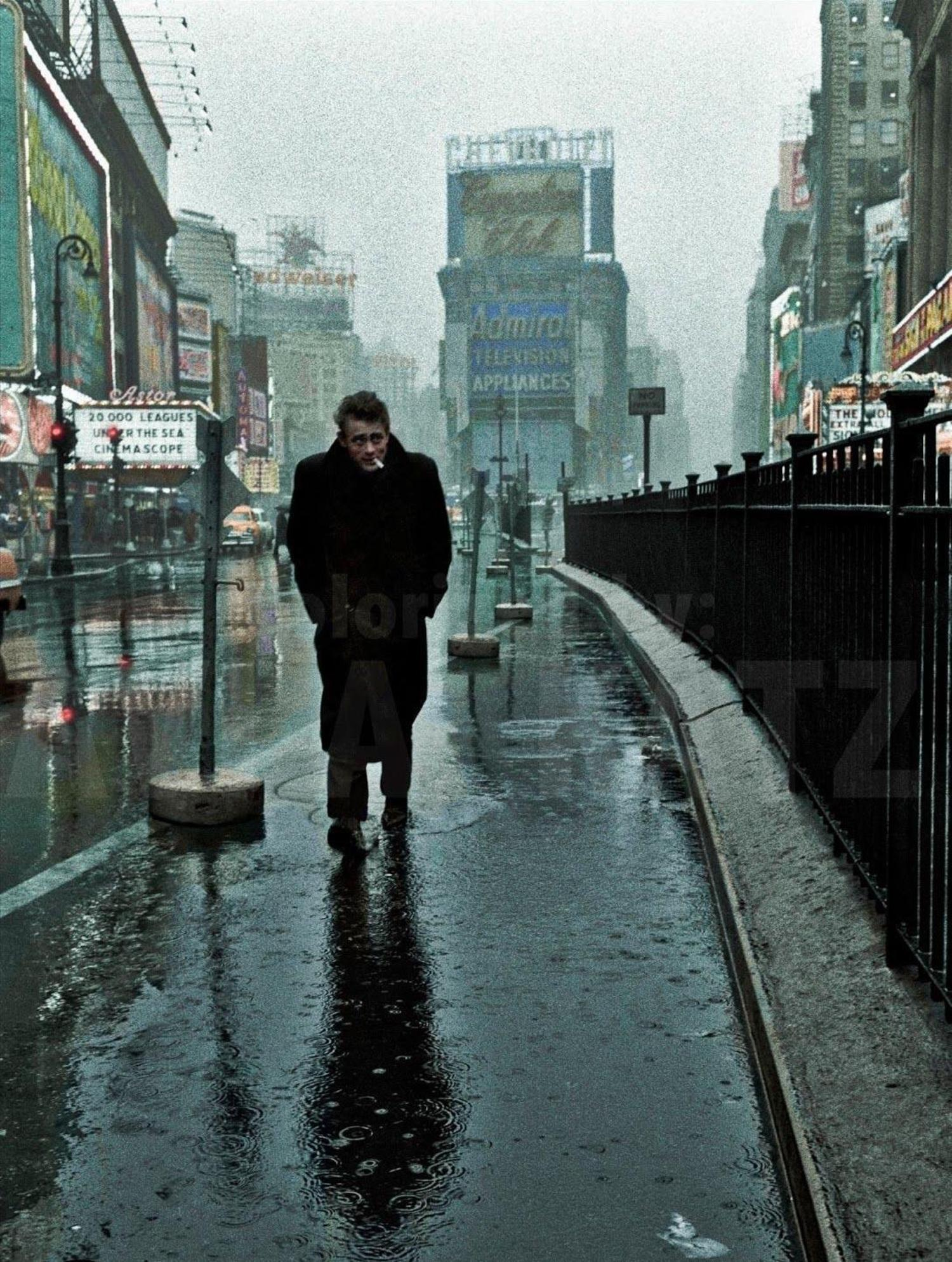 Actor James Dean on a rainy day in Times Square, 1955