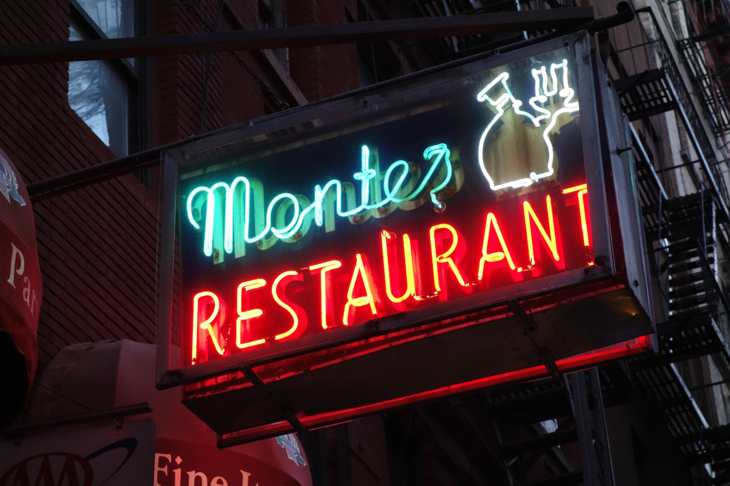 Historic neon sign for Monte's Restaurant on MacDougal Street