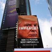 Giant billboard in Times Square calling from Donald Trump's resignation