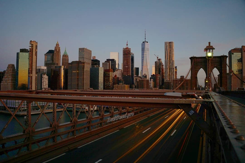 Sun rising on Brooklyn Bridge and Lower Manhattan