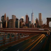 Sun rising on Brooklyn Bridge and Lower Manhattan