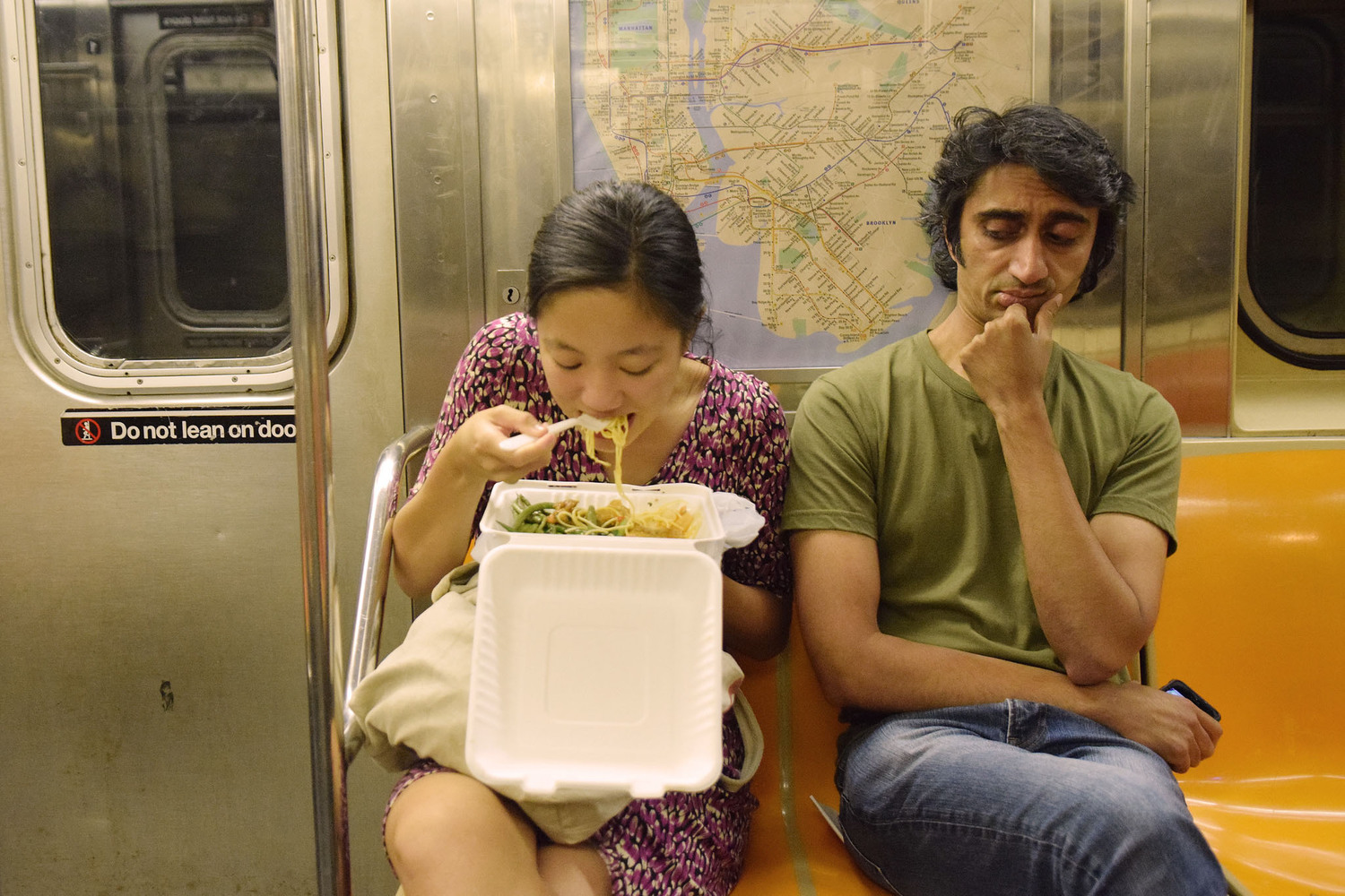 "Woman Eating Takeout on Subway While Man Gives Side Eye | You can use this photo for non-commercial purposes if you give credit, under this <a href=""https://creativecommons.org/licenses/by-nc/3.0/us/"" rel=""nofollow"">Creative Commons license</a>. For-profit media organizations also may use this, but as editorial content only (as illustrations for stories, for example, but not as advertising). Credit must read: Richard Yeh / WNYC  We'd love to know if you're using this photo - send us an email (jkeefe@wnyc.org)!"