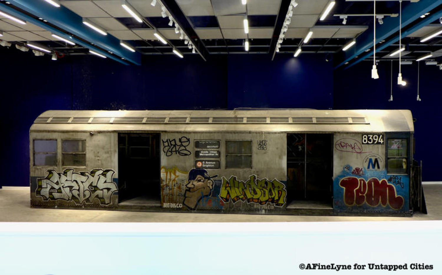 An Abandoned Graffitied NYC Subway Car Is Inside an Empty 42nd Street Storefront