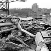 Some of a total of 16 cars left at a pier. Dec. 12, 1984.
