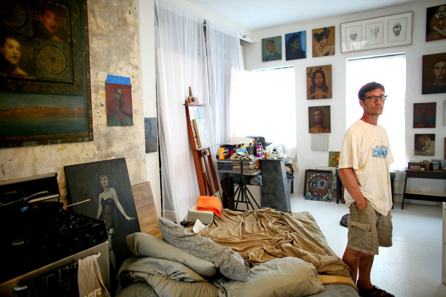 Steven Ashmore, inside his apartment in Umbrella House, was one of a handful of squatters who used a sledgehammer to break into the building in 1988.