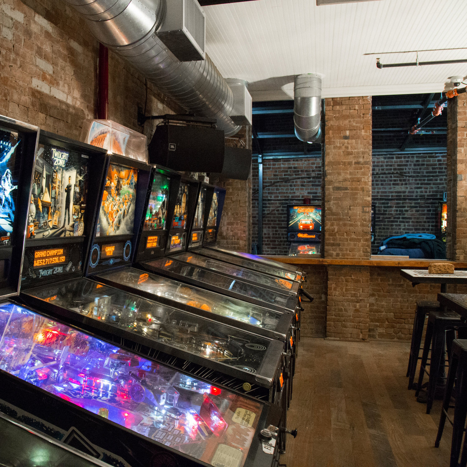 A row of pinball machines in the remodeled back room.