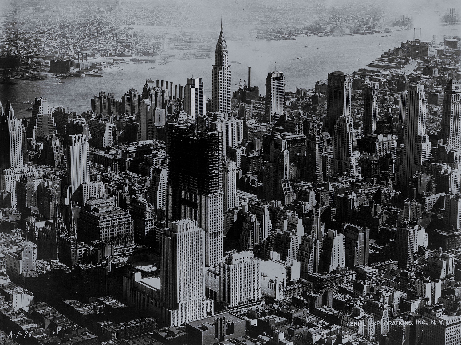 Rockefeller Center under construction, New York City, 1932 | Rockefeller Center rises in mid-Manhattan. Photograph by Hamilton M. Wright for Aerial Explorations, Inc., N.Y., 1932.