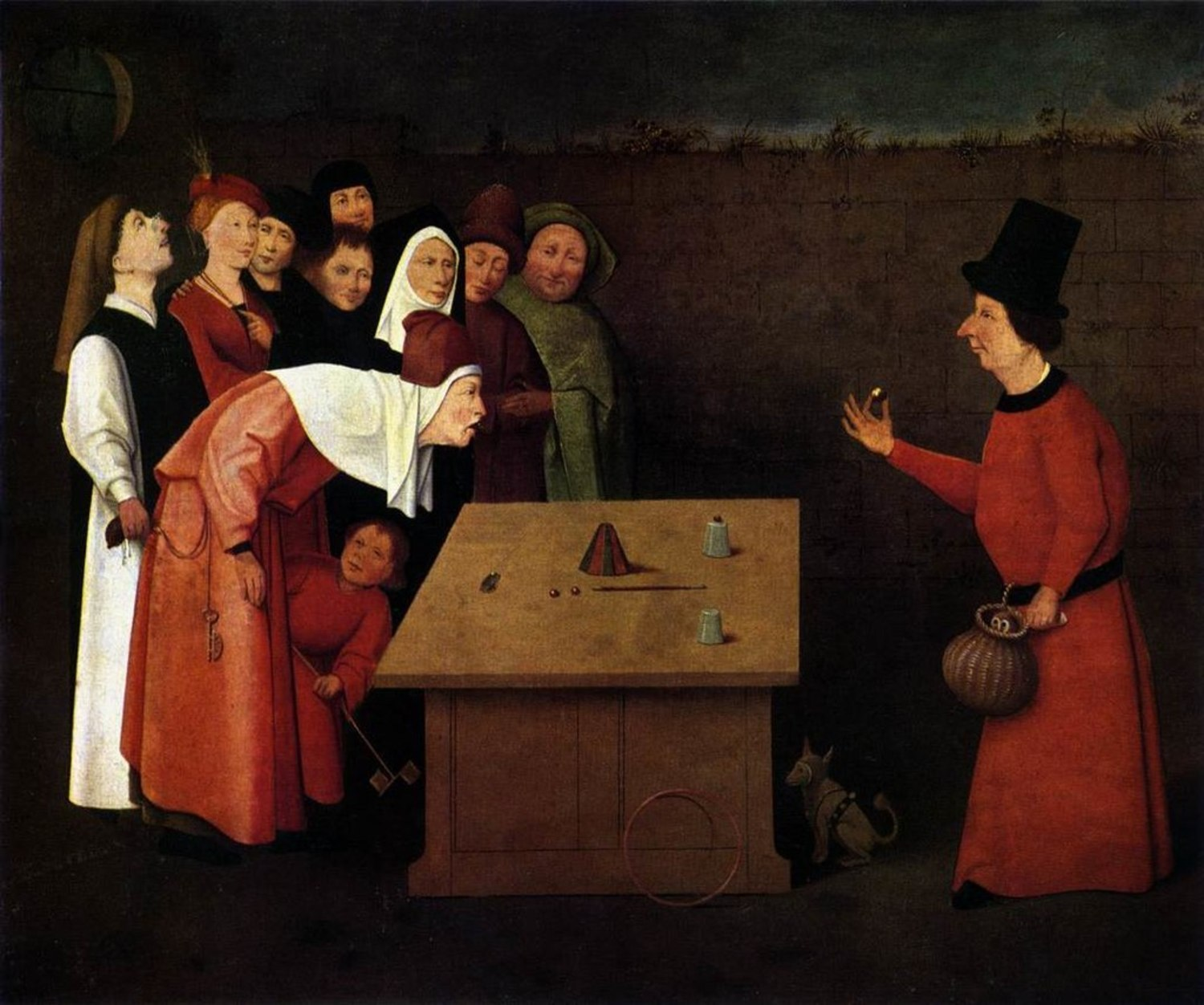 """""""The Conjurer,"""" painted by Hieronymus Bosch. The painting accurately displays a performer doing the cups and balls routine, which has been practiced since Egyptian times."""