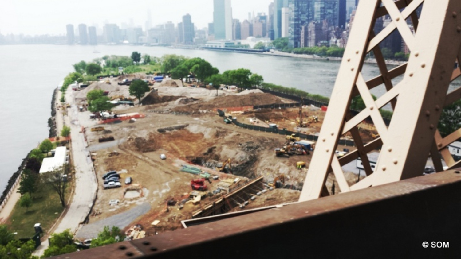 Construction photo showing early earth-moving at the site near the southern end of Roosevelt Island