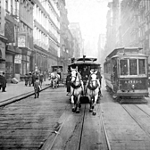 Just before the last of these vehicles was banished from the streets of New York City, the photographer snapped one of them as it passed alongside a 'Modern Electric Car' powered by the conduit between the rails. This photo was shot on Broadway just north of the intersection with Broome Street. The car is headed southbound.