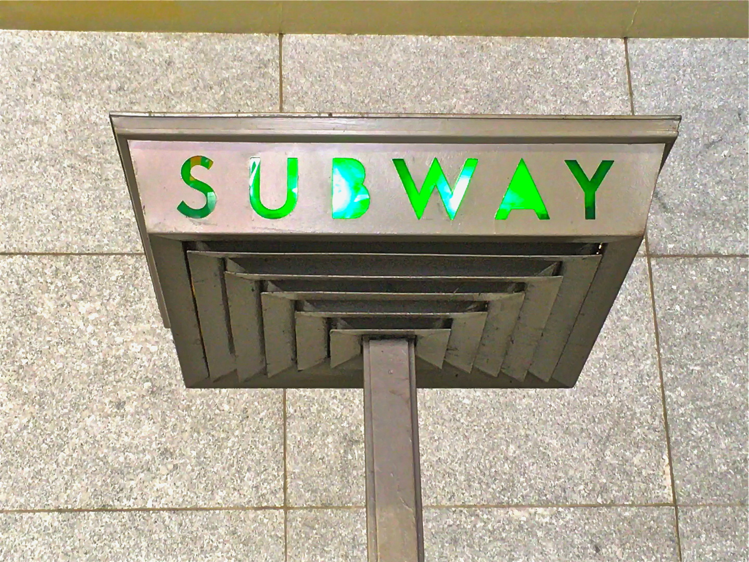 The coolest neon green subway sign in Brooklyn