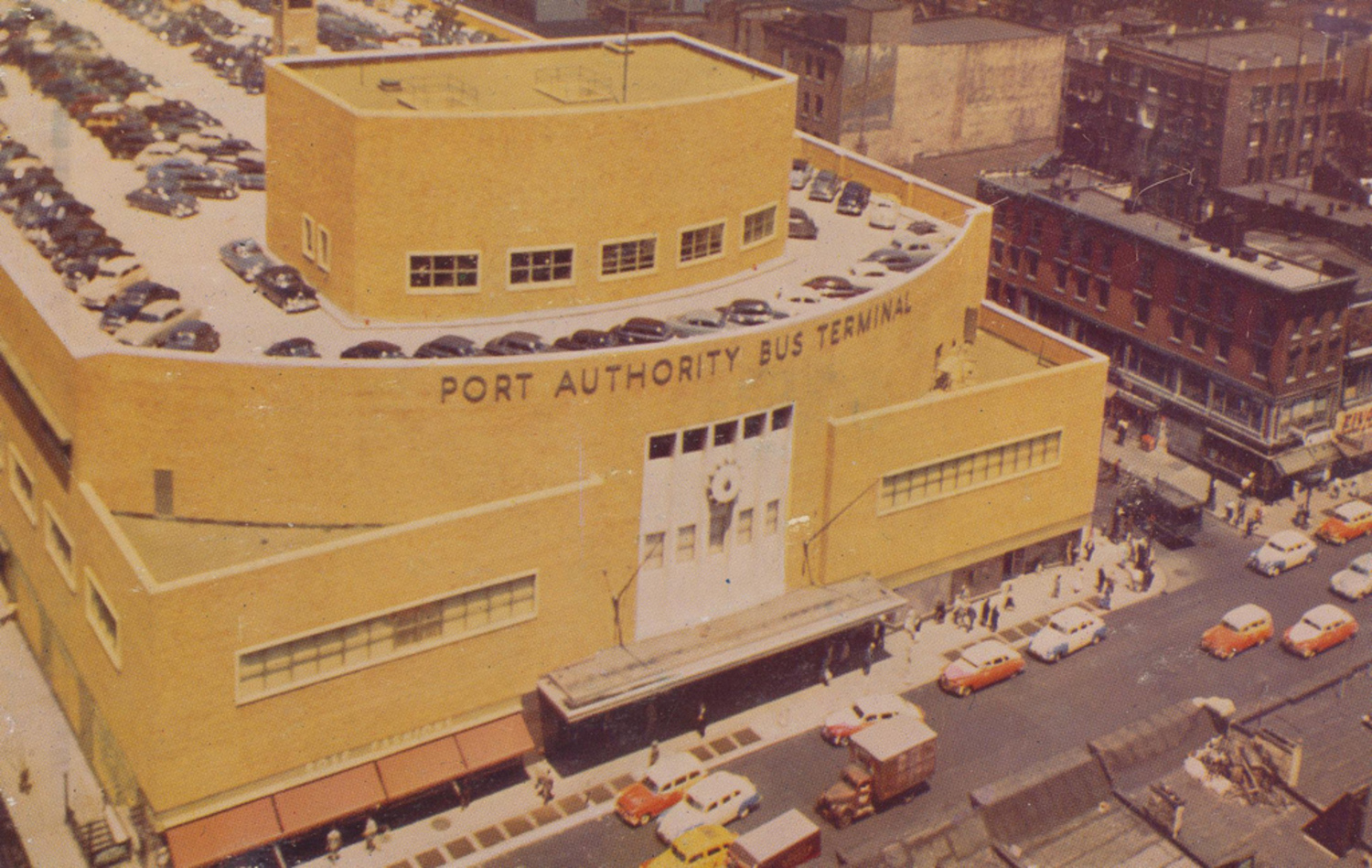 Port Authority Bus Terminal - New York, New York | New York City's newest Bus Terminal.  The postcard has the following written on the back:  from Empire State Building - August 11, 1952