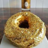 The Golden Cristal Ube Donut  The Manila Social Club presents their infamous gold-ube donut, adorned with icing made with Cristal champagne and filled with an ube mousse, champagne jelly, and covered with 24k Gold. $100 per donut.  For more information or to inquire about placing an order, please go to  www.ManilaSocialClub.com.  #manilasocialclub#williamsburg#newyears#ube#filipinofood#pinoyfood#donuts#goldleaf#champagne#doughnuts#nyc#f52grams#newforkcity#eatmunchies#eeeeeats#cristal#bubbly#bestrestaurants#cheflife#feastagram#buzzfeedfood#filipinofoodmovement#huffposttaste#forkyeah#feedfeed#tastingtable#eater#zagat#dessert#richdessert