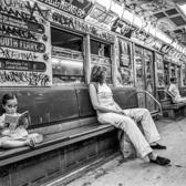 Little girl reads a book on the 1 train, summer of 1981