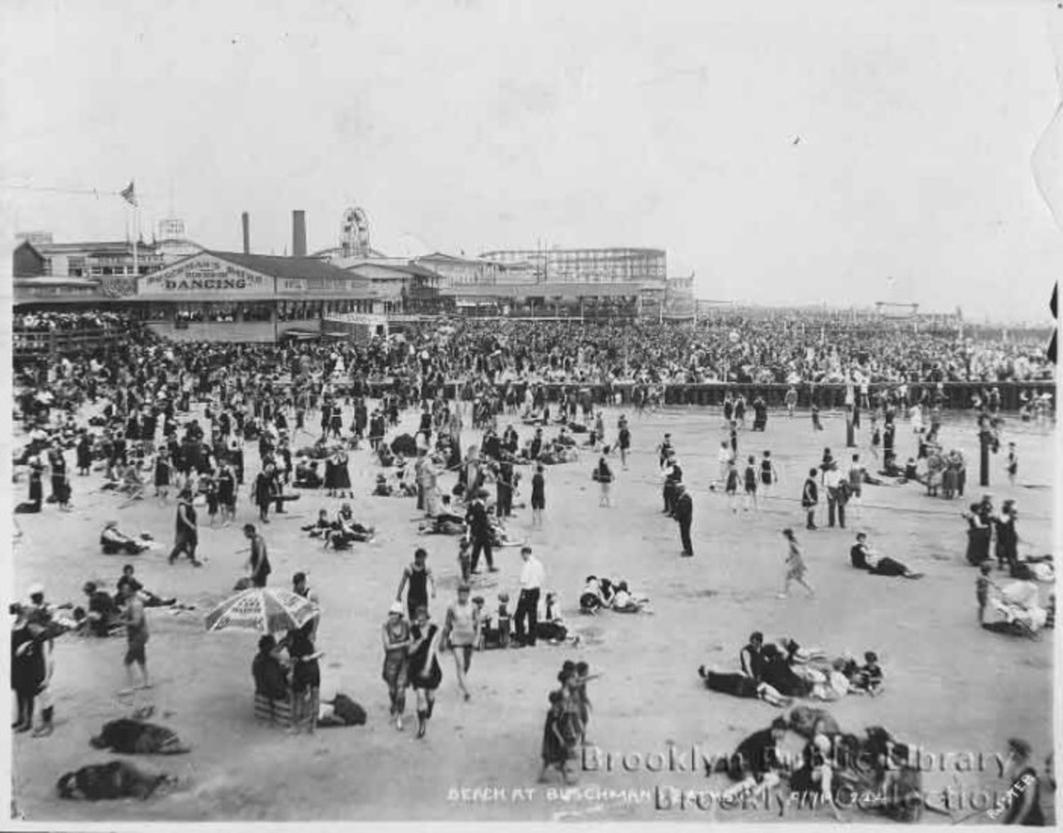 Don't see a lot of guys in suits on the beach nowadays. 1919