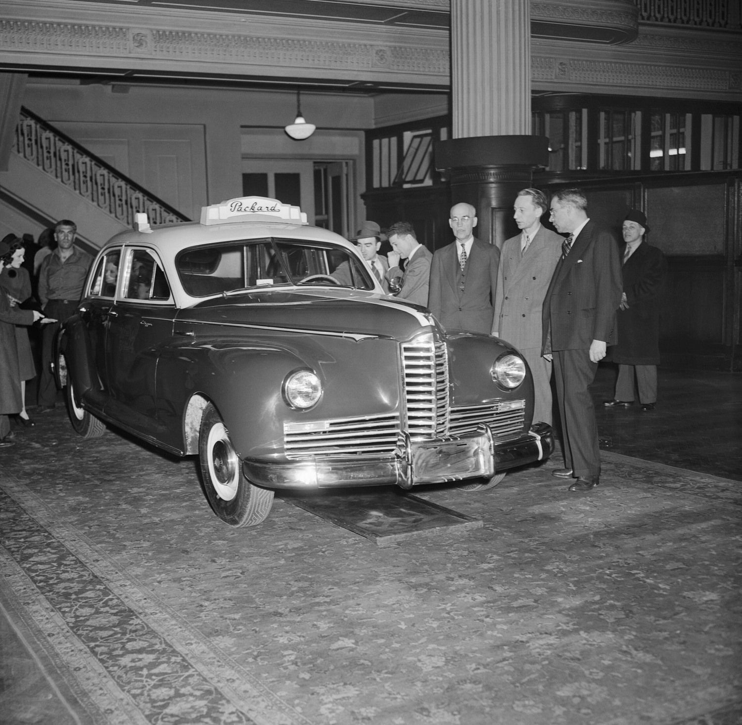 "G.H. Brodie, Assistant to the President of Packard Motor Car Co.; Sam Abramson, President of Yale Taxi Co. in New York; and Robert King, President of Packard Federal Corp. (left to right), pictured with the first postwar taxi, in 1946. One of its features was fitting five forward-facing passengers without the usual ""jump seats."""