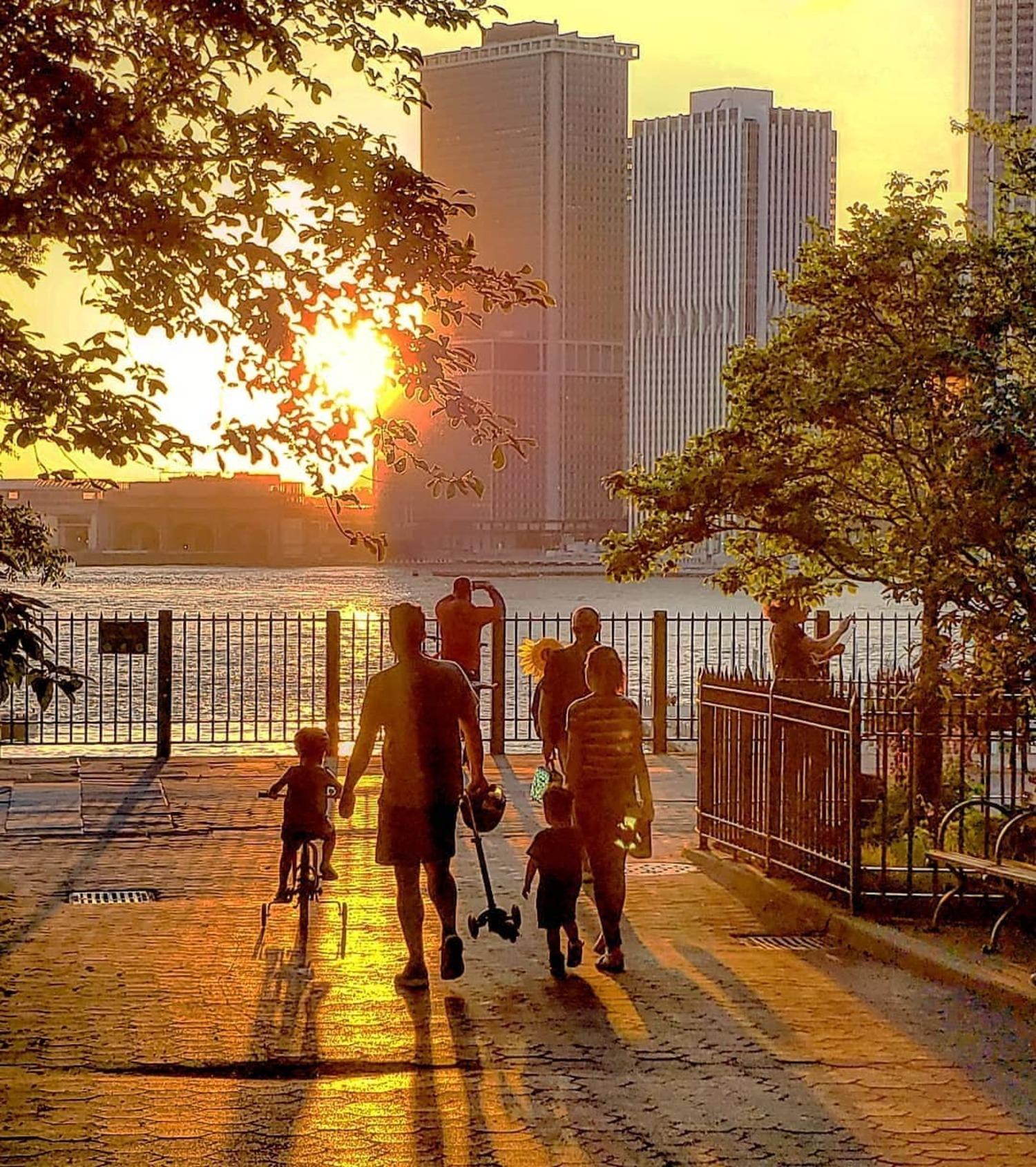 Sunset over Lower Manhattan skyline from Brooklyn Heights