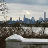 Manhattans cloudy skyline, viewed from The Bronx