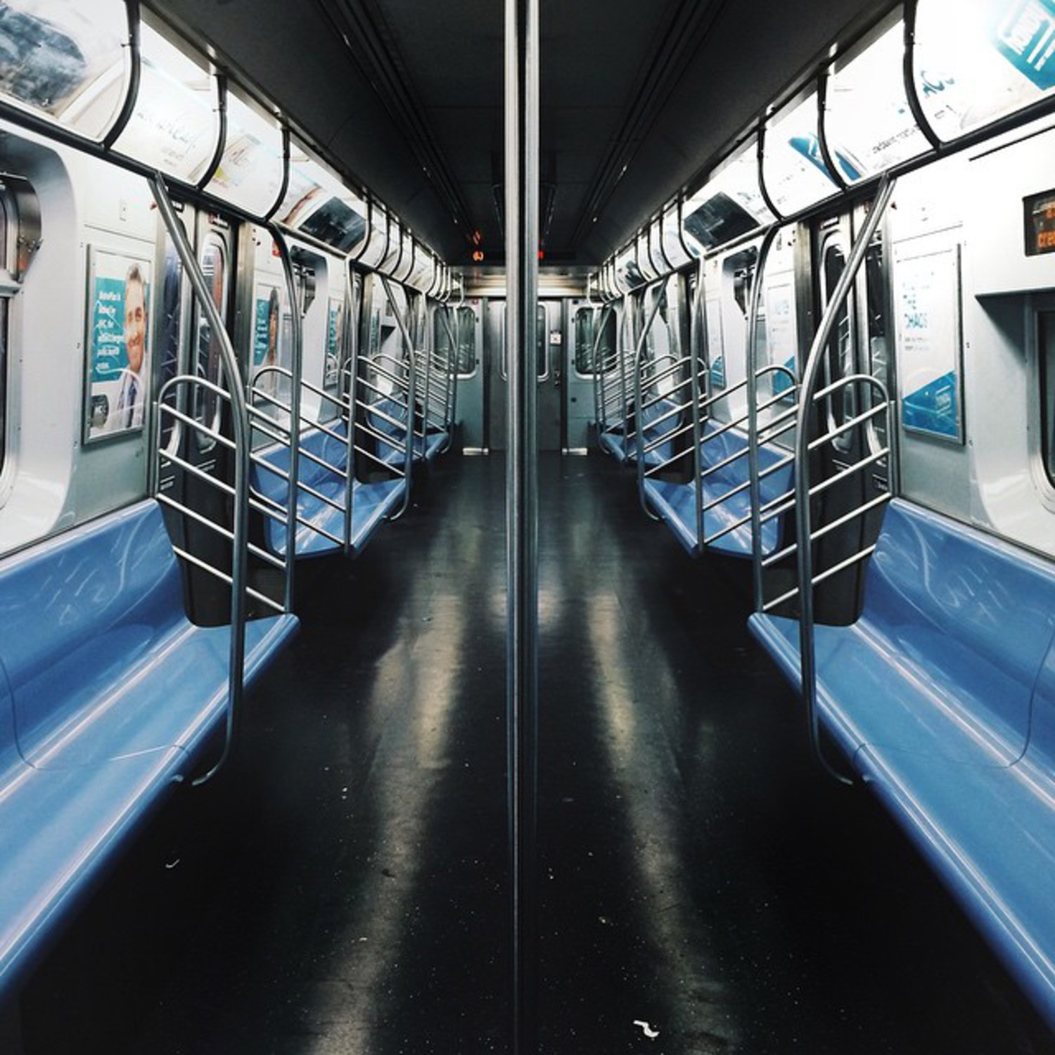 Symmetrical Subway Solitude #Ltrain #NYC #blue #black #symmetry #subway #NY #manhattan
