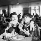 Mad Magazine artists Al Jaffee and Will Elder, in the lunchroom at the High School for Music and Arts in New York City, 1936