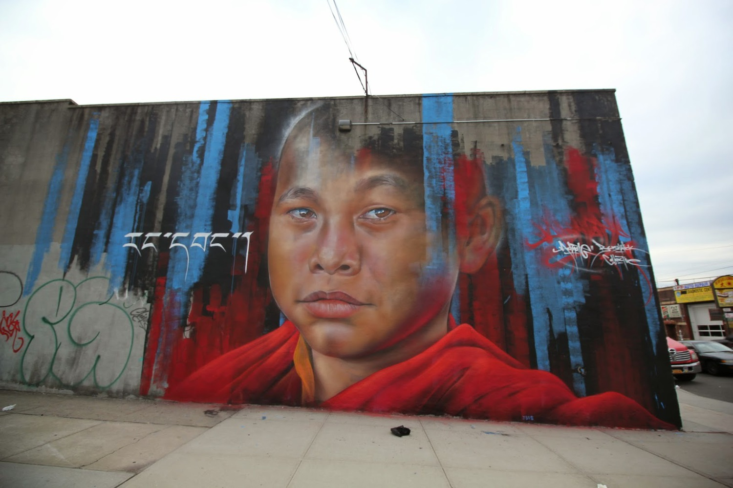 Adnate creates a new piece for The Bushwick Collective