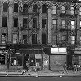 East side of Eighth Avenue, between 119th and 120th Streets, 1970s