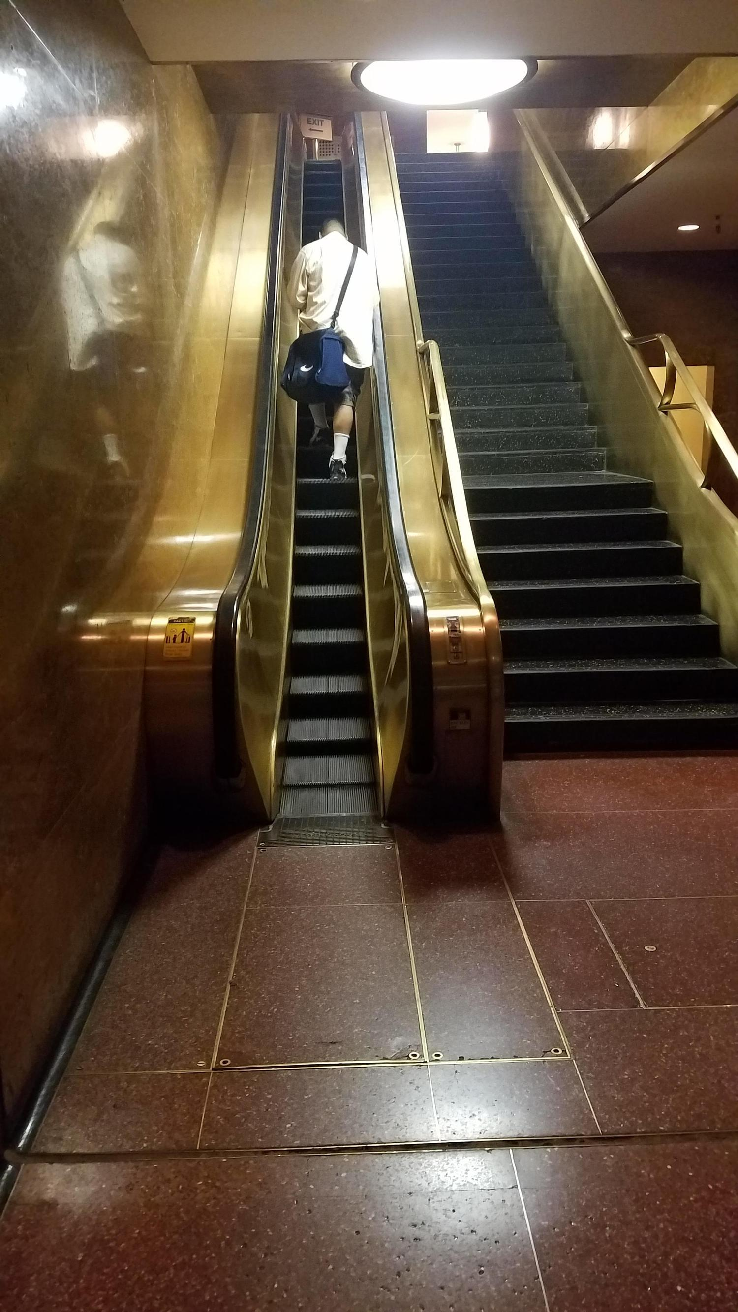This really narrow escalator at 30 Rockefeller Center