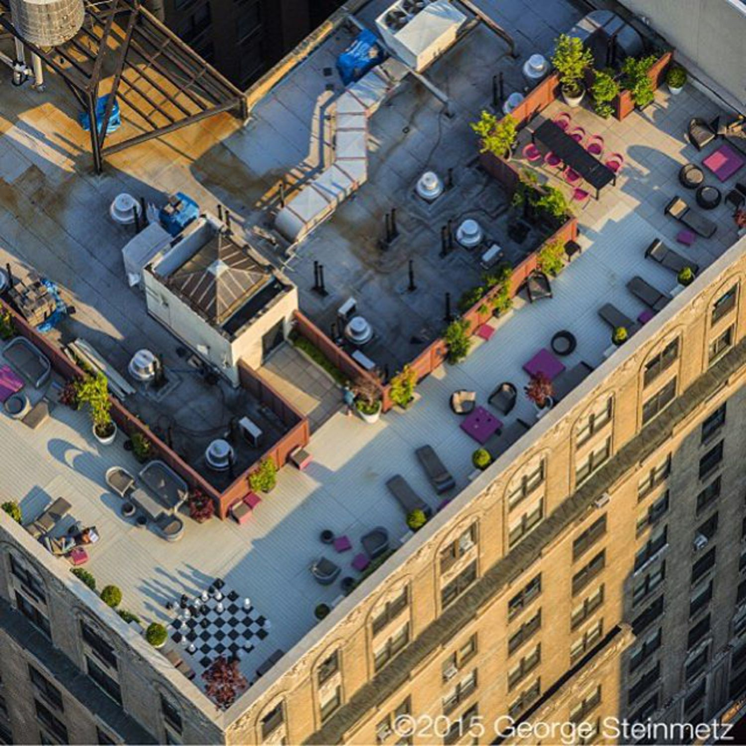 Photograph by George Steinmetz @geosteinmetz / @thephotosociety  Chess Manhattan style … on the rooftop at #TheGreystone, 2454 Broadway, in #NewYorkCity. The building was originally constructed in 1923 as a stately hotel and renovated into luxury apartments.
