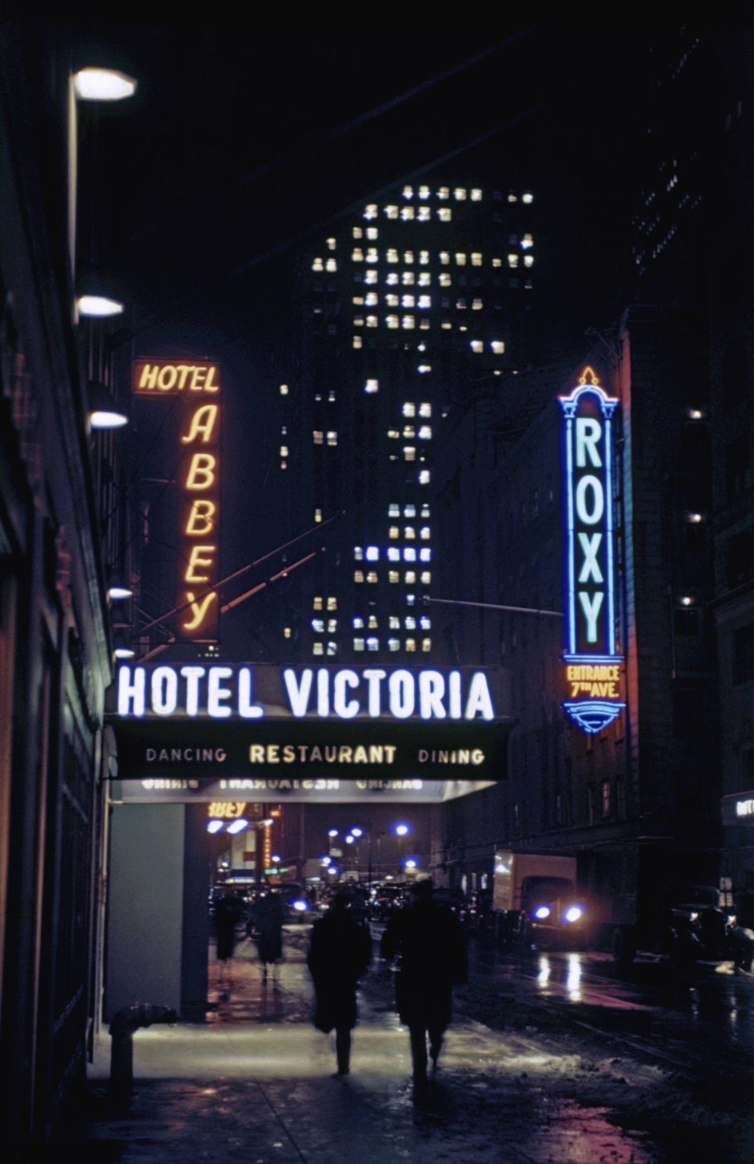 1946 New York street showing the Hotel Abbey, Hotel Victoria and the Roxy in Times Square. In the background is the Rockefeller Center.