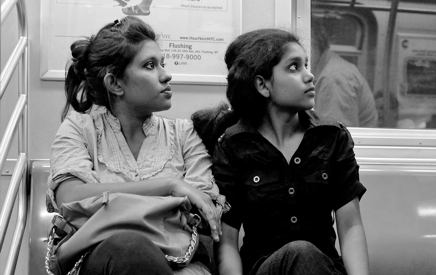 New York Street Scenes | Mother and daughter on the F train.