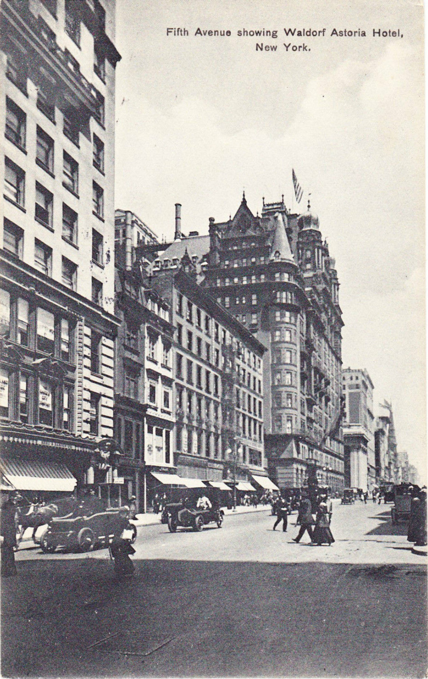 This photo postcard taken around 1915 is looking north on Fifth Avenue from 32nd Street. The turreted Waldorf-Astoria Hotel with its American flag raised on the roof is the focal point of this scene. There are no traffic signals to interrupt the  vehicular traffic on the avenue. People cross the street with little difficulty as the traffic is light.