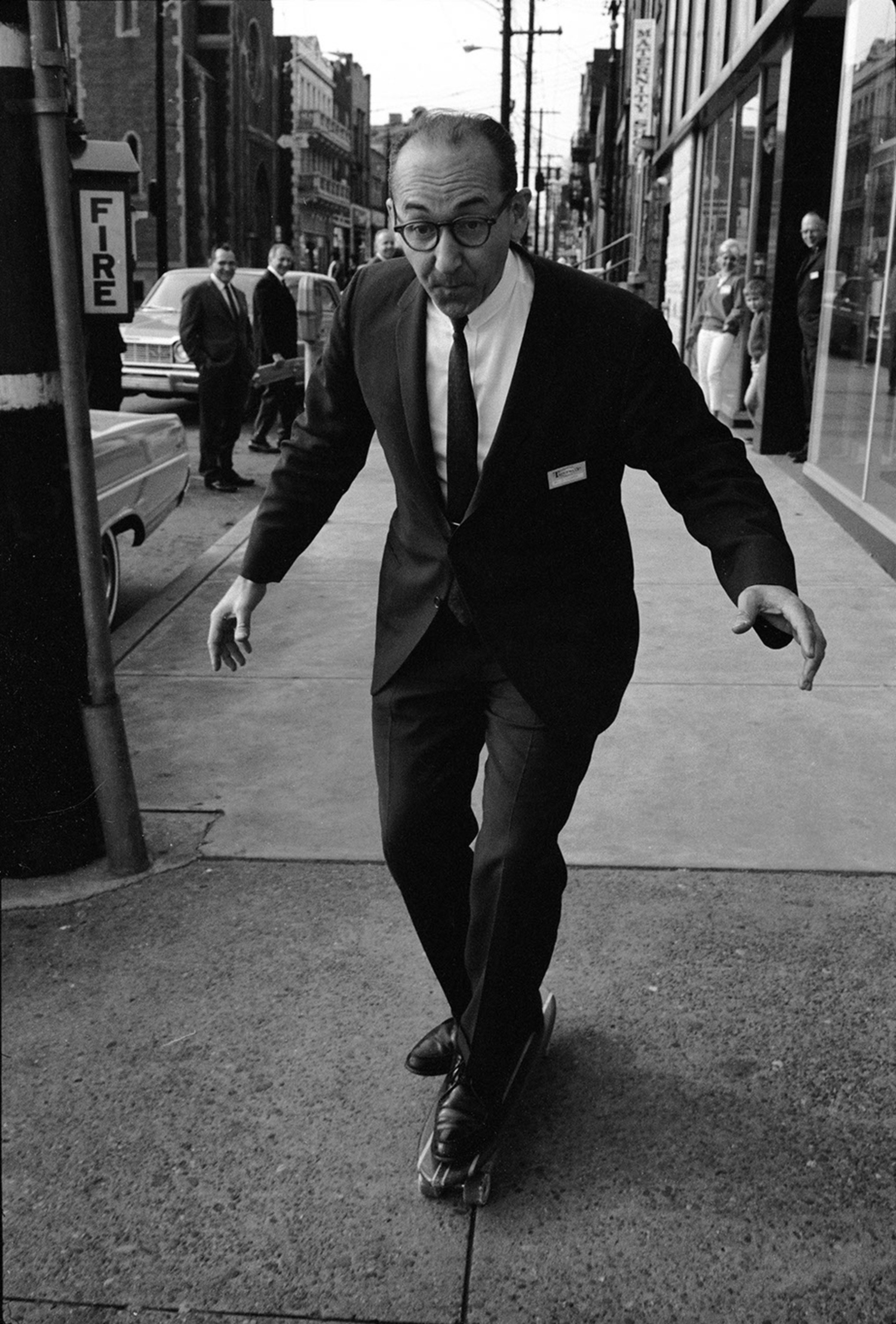 A well-dressed man cruises down the streets of New York, breaking hearts as he goes.