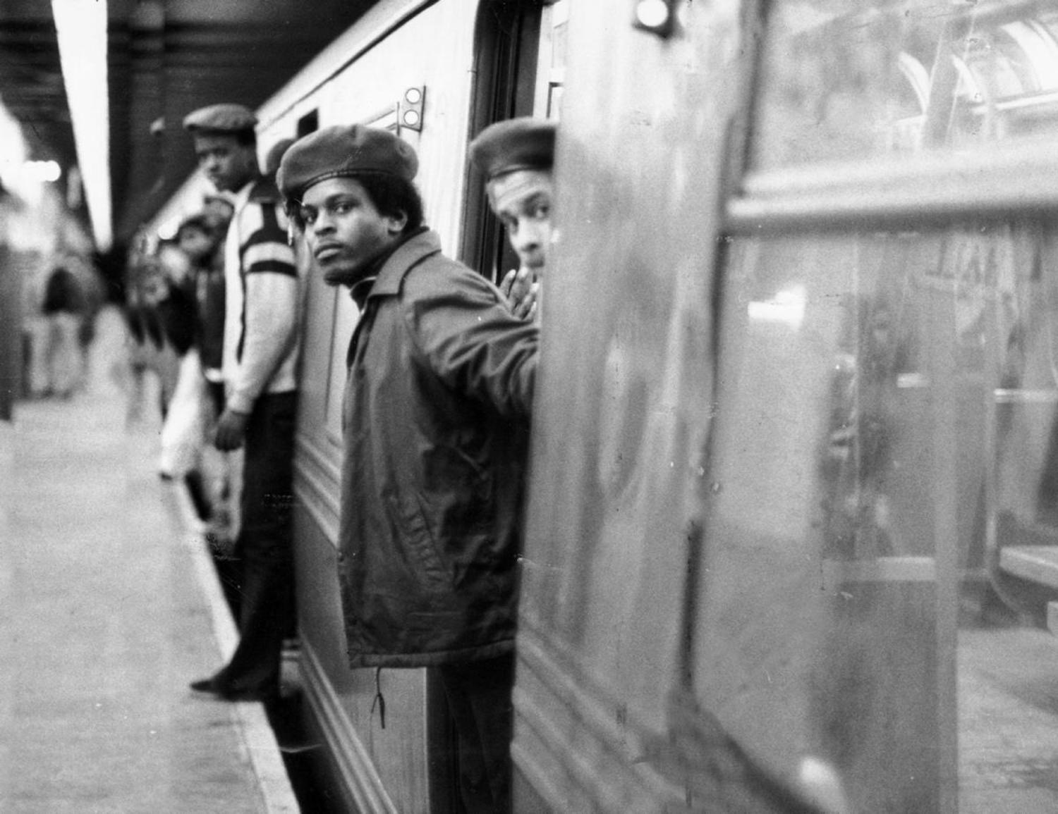 1980's: Members of the volunteer crime fighting organization, The Guardian Angels, patrol a subway car. The group was founded in 1979 in New York City in response to the increase in crime on the subway.