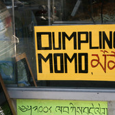 """Dumpling momo"" sign at Merit Kabab Palace, Jackson Heights"