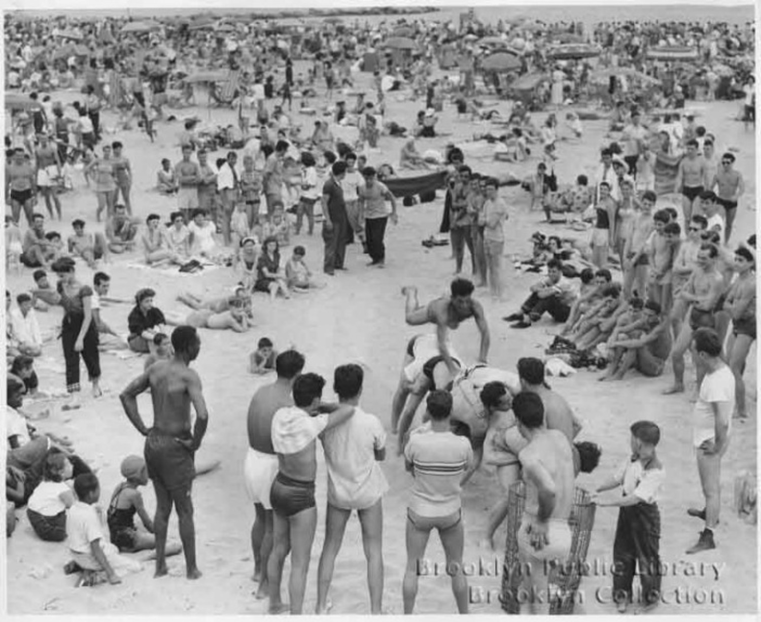 The original caption says that on this date in 1953, 1.3M people visited Coney Island!