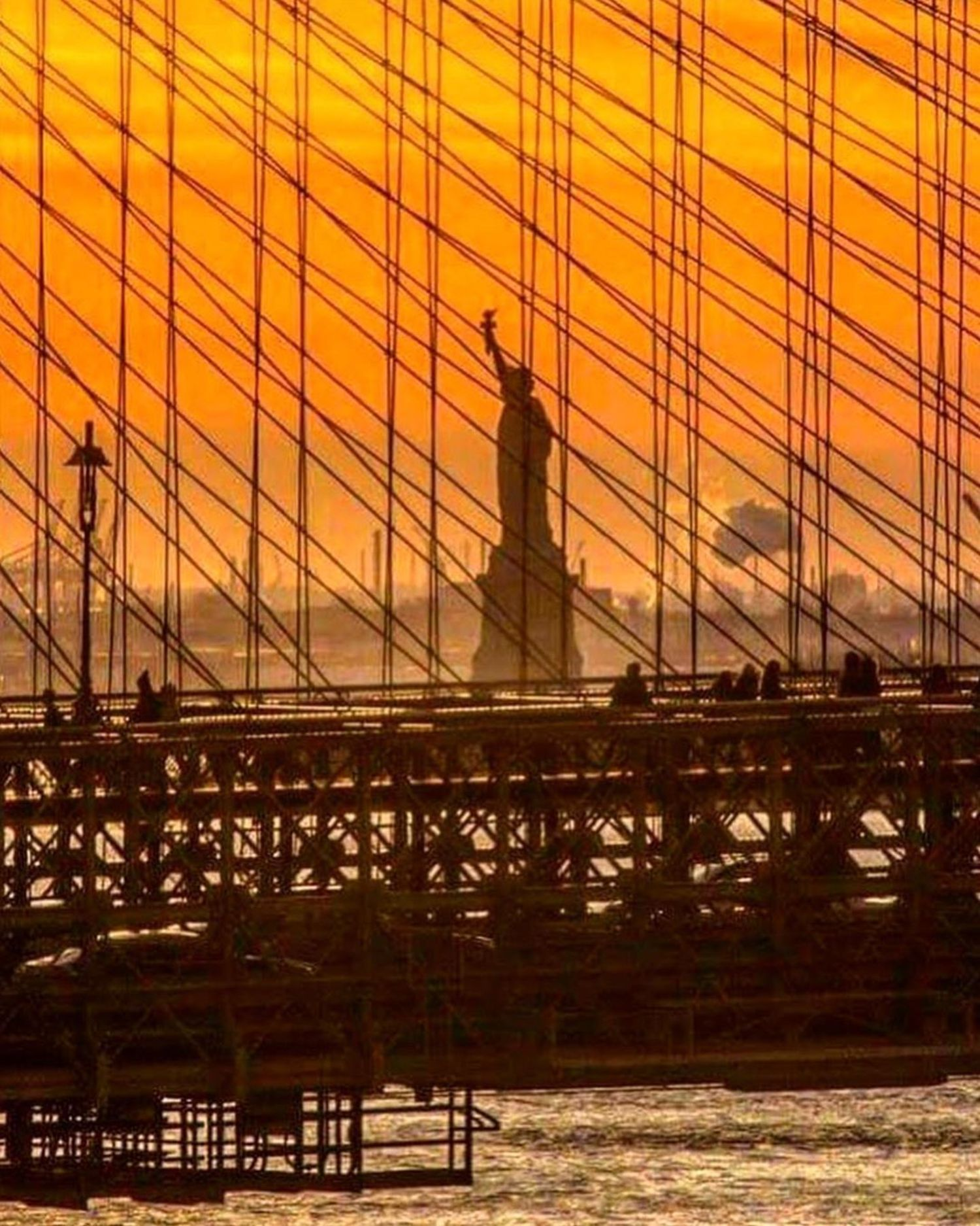 Statue of Liberty through the Brooklyn Bridge, New York