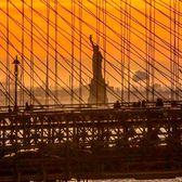 Statue of Liberty through the Brooklyn Bridge, New York