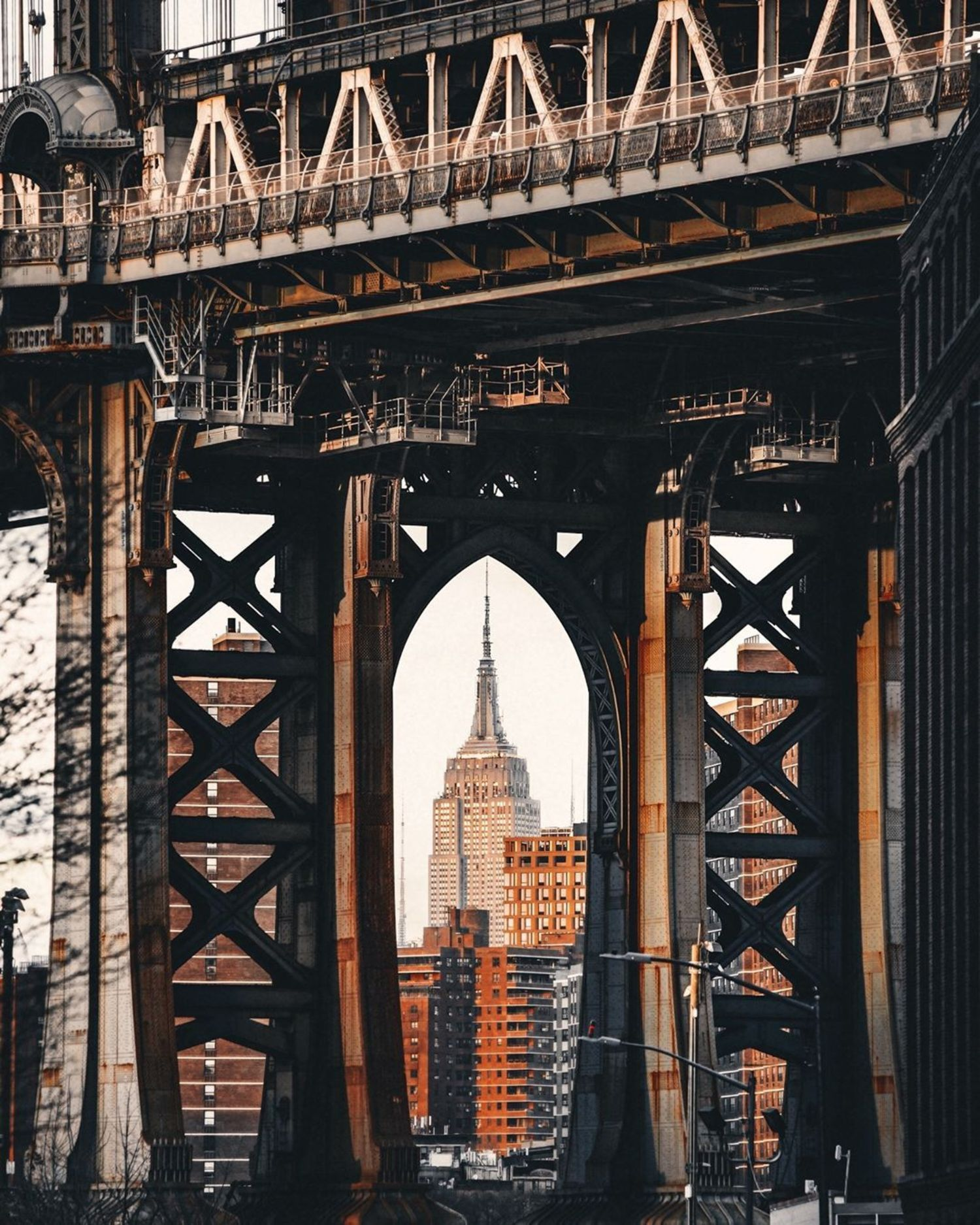 Empire State Building seen through Manhattan Bridge from DUMBO, Brooklyn