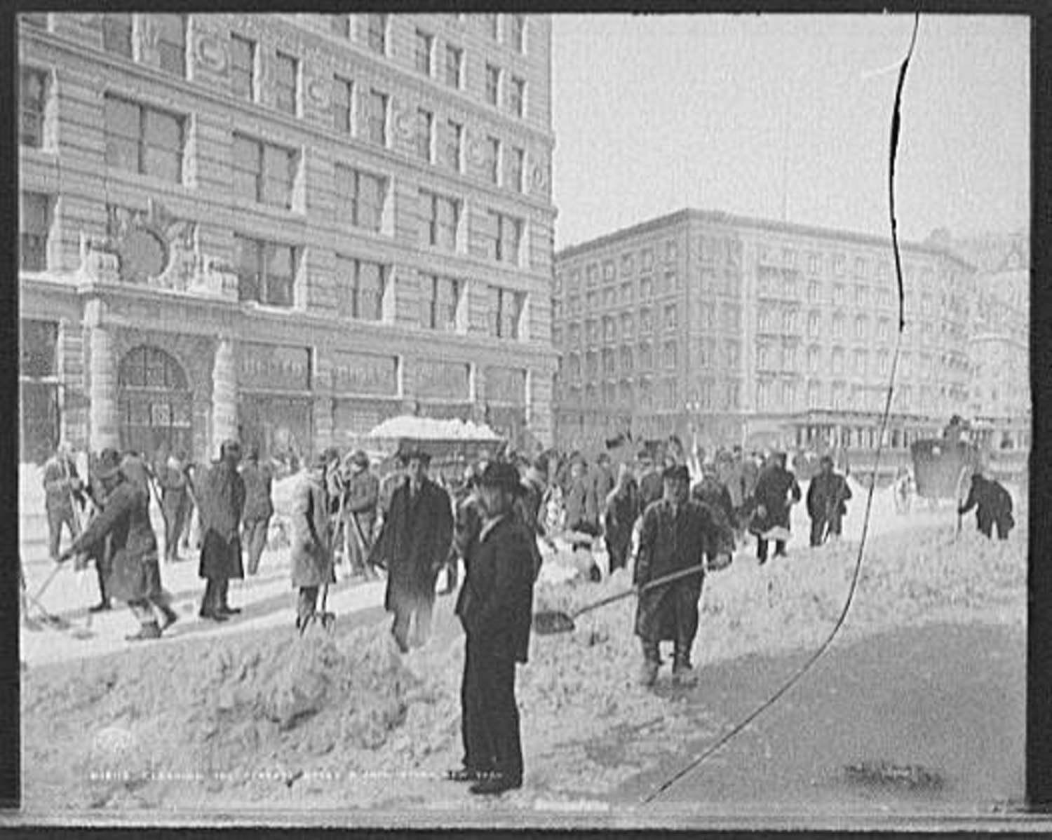 Cleaning the streets after a snow storm, New York. Broadway and 23rd St, 1905